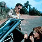 Patricia Arquette and Michael Madsen in Trouble Bound (1993)
