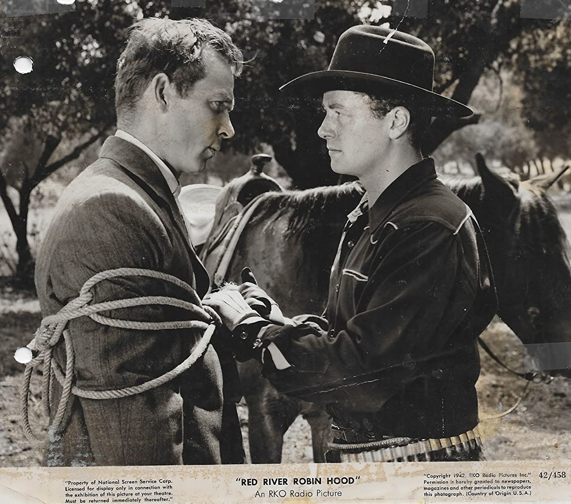 Eddie Dew and Tim Holt in Red River Robin Hood (1942)
