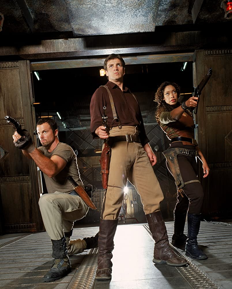 Adam Baldwin, Nathan Fillion, and Gina Torres in Firefly (2002)