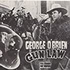 George O'Brien and Rita Oehmen in Gun Law (1938)
