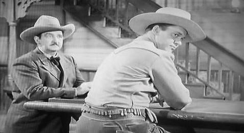 Kirby Grant and Charles King in Lawless Breed (1946)