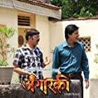 Makarand Anaspure and Sandeep Gaikwad in Angarki (2013)