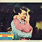 Richard Conte and Dianne Foster in The Brothers Rico (1957)