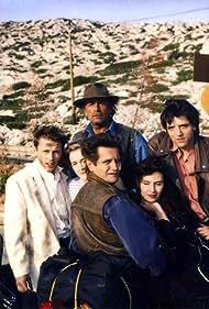 Lola Gans, Maxime Leroux, Hervé Laudière, Matthieu Rozé, Laura del Sol, and Venantino Venantini in Les noces de Lolita (1993)