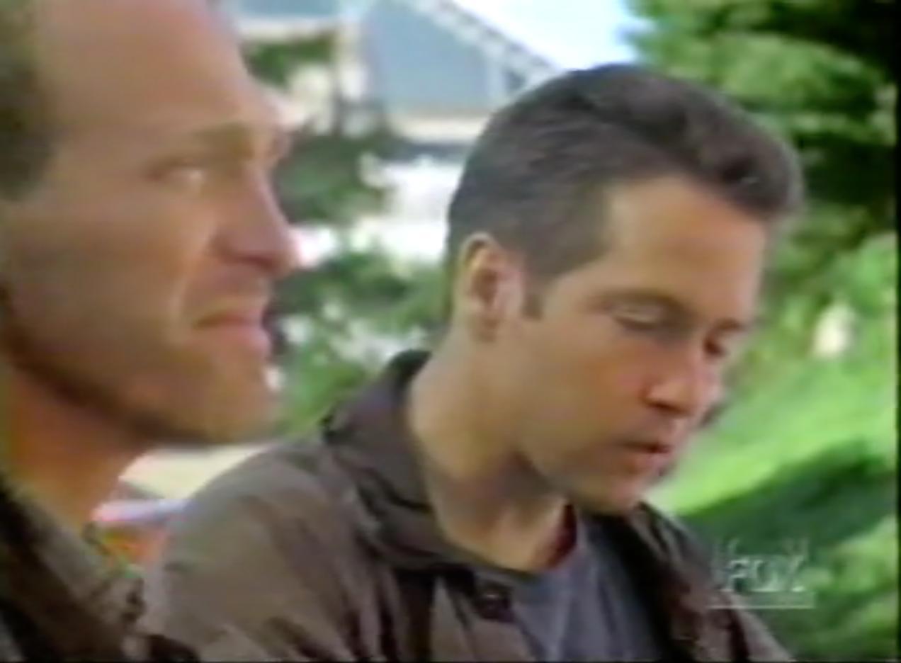 D.B. Sweeney and Mark Rolston in Strange Luck (1995)