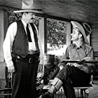 Ed Cassidy and Tex Ritter in Rollin' Plains (1938)
