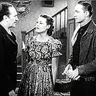 Harriet Bennet, Karl Hackett, and Tex Ritter in Rollin' Plains (1938)