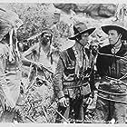Bill Elliott and Frank Lackteen in The Great Adventures of Wild Bill Hickok (1938)