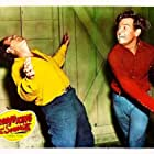 Rex Allen and Tristram Coffin in Rodeo King and the Senorita (1951)