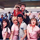 Michelle Pfeiffer, Christopher McDonald, Lorna Luft, Peter Frechette, Leif Green, Alison Price, Maureen Teefy, and Adrian Zmed in Grease 2 (1982)