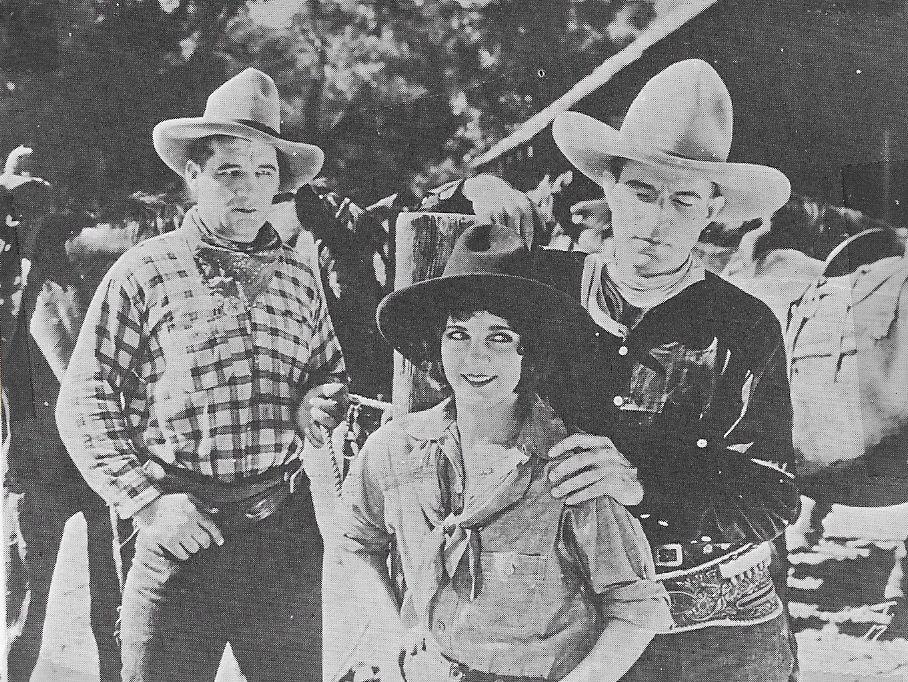 Vivian Bay, Bob Custer, and Walter Patterson in The Oklahoma Kid (1929)