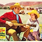 Gene Autry and Lois Wilde in The Singing Cowboy (1936)
