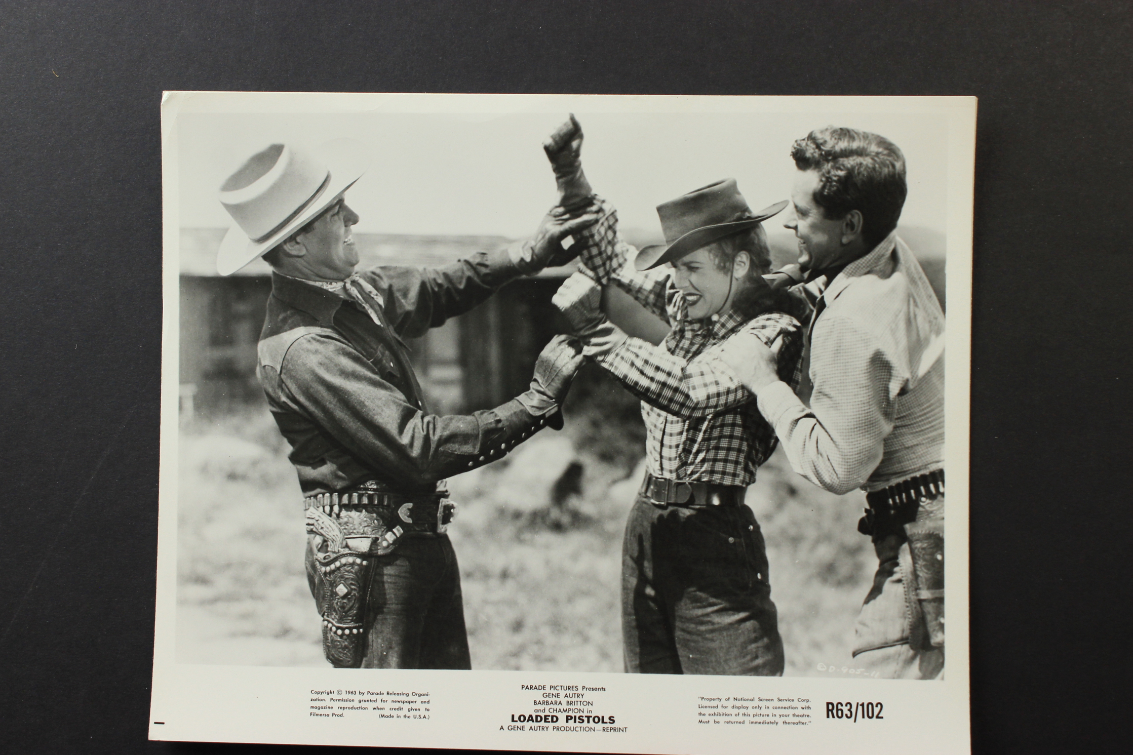 Gene Autry, Russell Arms, and Barbara Britton in Loaded Pistols (1948)