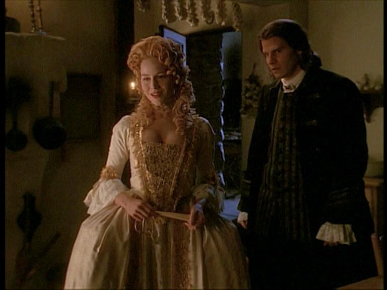 Julie Benz and David Boreanaz in Angel (1999)