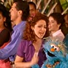 Gloria Estefan and Carmen Osbahr in Elmopalooza! (1998)