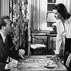Joan Bennett and Paul Henreid in Hollow Triumph (1948)