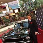 Mel Novak at the event of Steve McQueen: American Icon with the car from the movie Bullitt