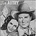 Gene Autry, Smiley Burnette, and Kay Hughes in Ride, Ranger, Ride (1936)