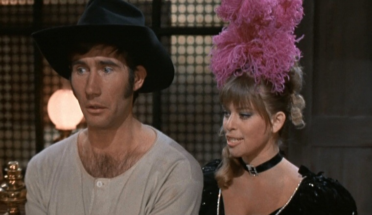 Jim Dale and Edina Ronay in Carry On Cowboy (1965)