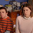 Eden Sher and Atticus Shaffer in The Middle (2009)