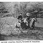 Bob Baker, Glenn Strange, and Apache in The Last Stand (1938)