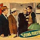 Walter Catlett, Harold Huber, Allen Jenkins, and Dick Powell in Going Places (1938)