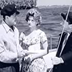 Robert Taylor, Philo Hauser, and Nicole Maurey in The House of the Seven Hawks (1959)