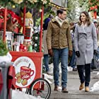 Paul Campbell and Kimberley Sustad in A Godwink Christmas (2018)
