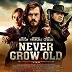 John Cusack, Tim Ahern, Emile Hirsch, and Déborah François in Never Grow Old (2019)