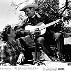 Gene Autry and Gail Davis in Texans Never Cry (1951)