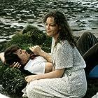 Harvey Keitel and Romy Schneider in La mort en direct (1980)