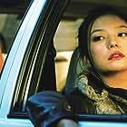 Gaowa Siqin and Wei Zhao in Yi ma de hou xian dai sheng huo (2006)