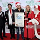 Erik Estrada, Laura McKenzie, and Bret Michaels at an event for 88th Annual Hollywood Christmas Parade (2019)