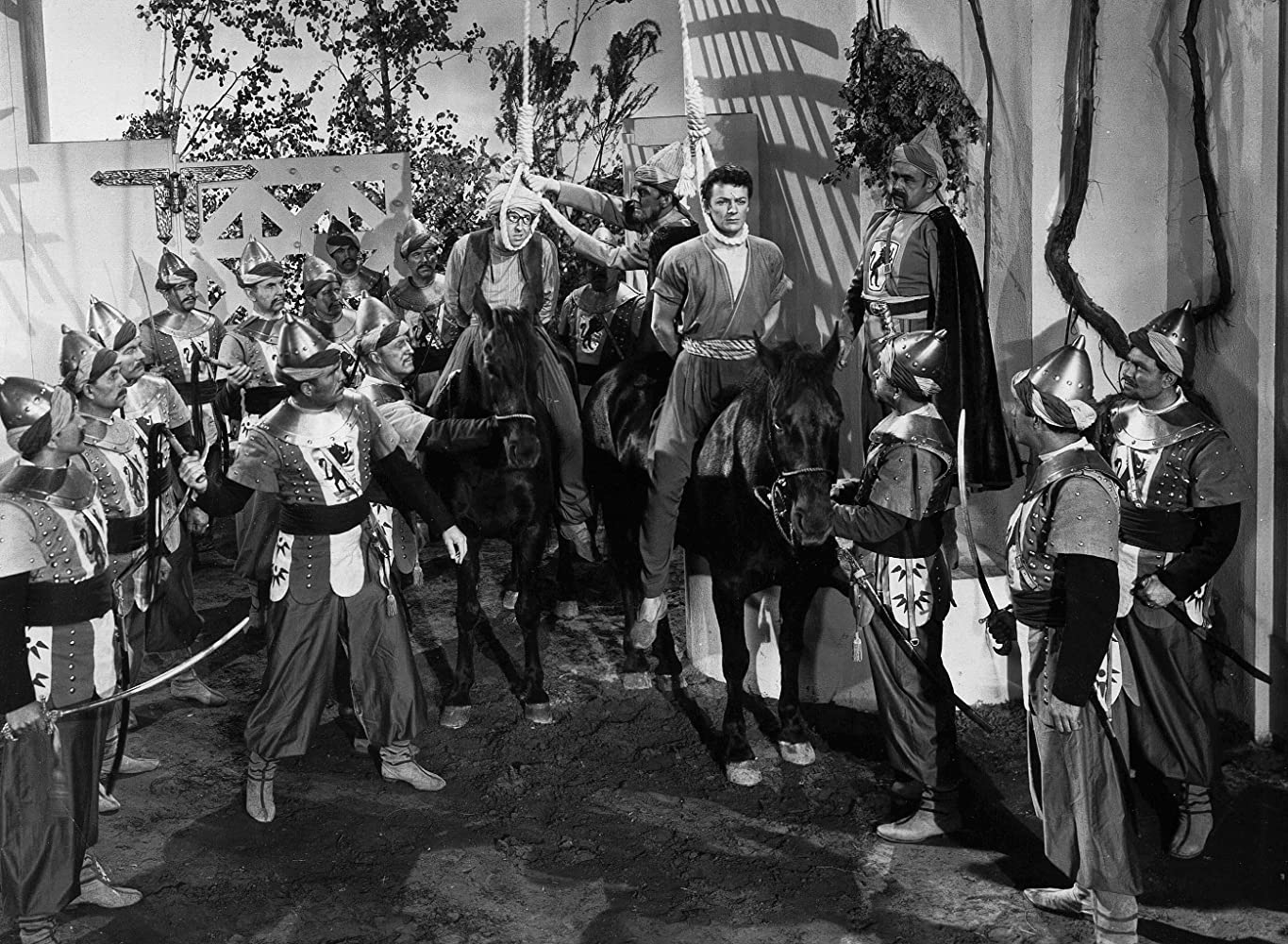 Nestor Paiva, Cornel Wilde, and Phil Silvers in A Thousand and One Nights (1945)