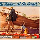 John Wayne, Dorothy Gulliver, and Lloyd Whitlock in The Shadow of the Eagle (1932)