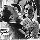 Grégoire Aslan and Eddie Constantine in Cet homme est dangereux (1953)