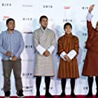Ugyen Norbu Lhendup, Sonam Tashi, Sherab Dorji, and Pawo Choyning Dorji at an event for Lunana: A Yak in the Classroom (2019)