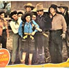 Gene Autry, Johnny Bond, Smiley Burnette, Edith Fellows, Cactus Mack, Fay McKenzie, Jean Porter, and Tex Terry in Heart of the Rio Grande (1942)