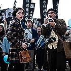 Johnny Depp and Minami in Minamata (2020)