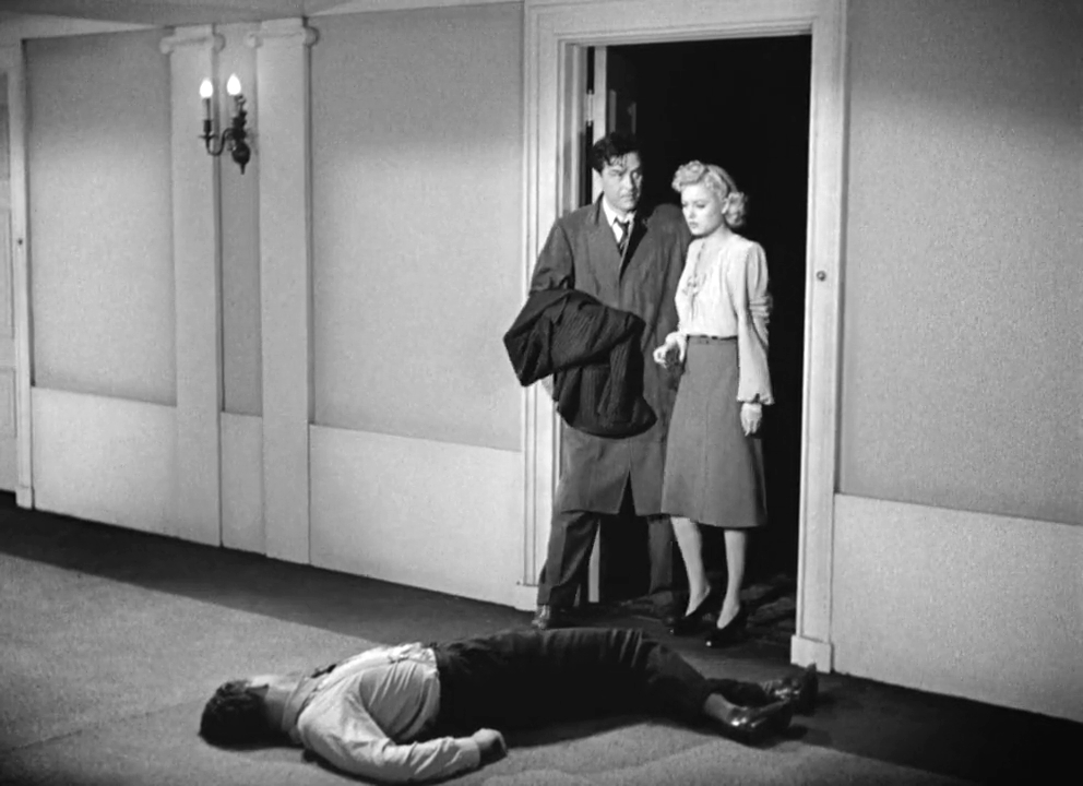 Ray Milland, Carl Esmond, and Marjorie Reynolds in Ministry of Fear (1944)