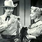 Mari Blanchard and John Payne in Rails Into Laramie (1954)