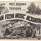 Roy Rogers, Pat Brady, and Paul Kelly in Man from Music Mountain (1943)