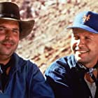 Billy Crystal and Jon Lovitz in City Slickers II: The Legend of Curly's Gold (1994)