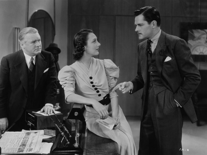 Joseph Crehan, Ann Dvorak, and Donald Woods in The Case of the Stuttering Bishop (1937)