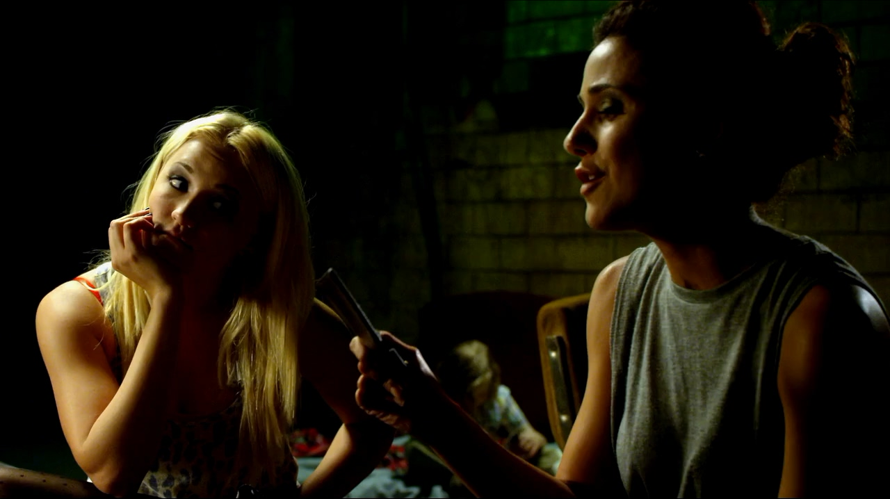 Emmanuelle Chriqui and Emily Osment in Cleaners (2013)