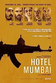 Jason Isaacs, Anupam Kher, Nazanin Boniadi, Armie Hammer, and Dev Patel in Hotel Mumbai (2018)