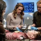 Tom Felton, Danielle Panabaker, Grant Gustin, and Carlos Valdes in The Flash (2014)