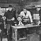 John Wayne, Clarence Geldert, Frank McHugh, and Bud Osborne in The Telegraph Trail (1933)