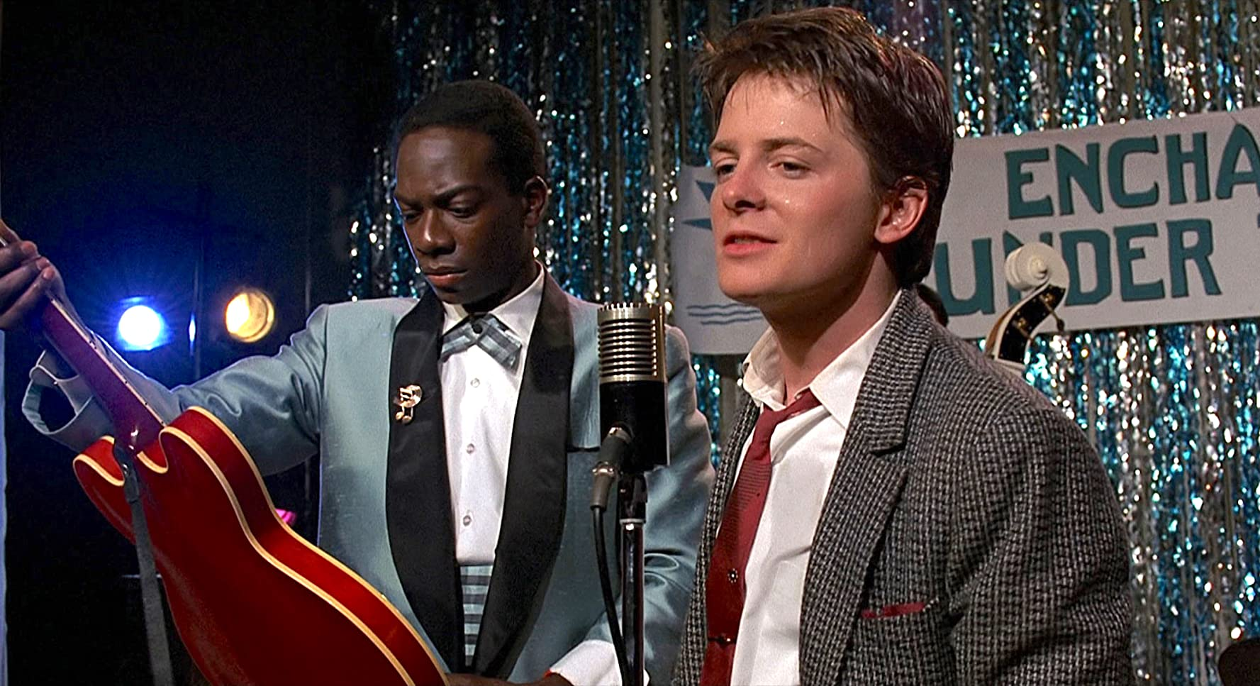 Michael J. Fox and Harry Waters Jr. in Back to the Future (1985)