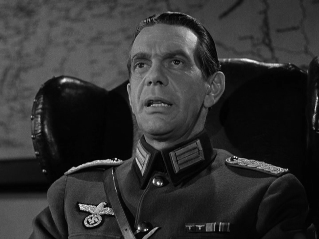 Raymond Massey in Desperate Journey (1942)